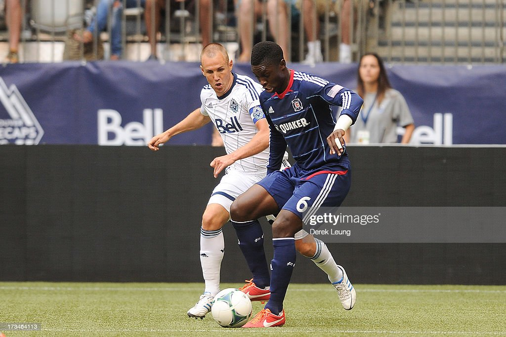 <a gi-track='captionPersonalityLinkClicked' href=/galleries/search?phrase=Kenny+Miller&family=editorial&specificpeople=213276 ng-click='$event.stopPropagation()'>Kenny Miller</a> #9 of the Vancouver Whitecaps tries to check Jalil Anibaba #6 of Chicago Fire during an MLS Match at B.C. Place on July 14, 2013 in Vancouver, British Columbia, Canada.