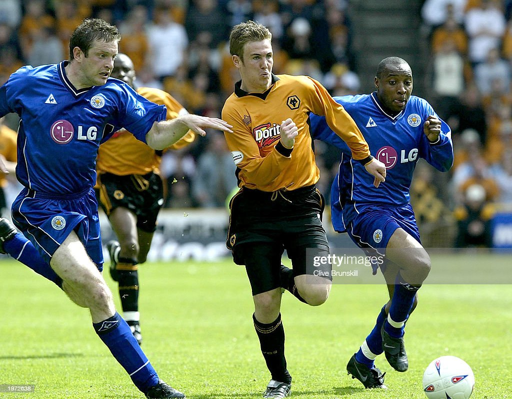 Kenny Miller of Wolves is pursued by Andy Impey and Gerry Taggart of Leicester on his way to scoring during The Nationwide First Division match between Wolverhampton Wanderers and Leicester City on May 4, 2003 at the Molineux Stadium in Wolverhampton, England.