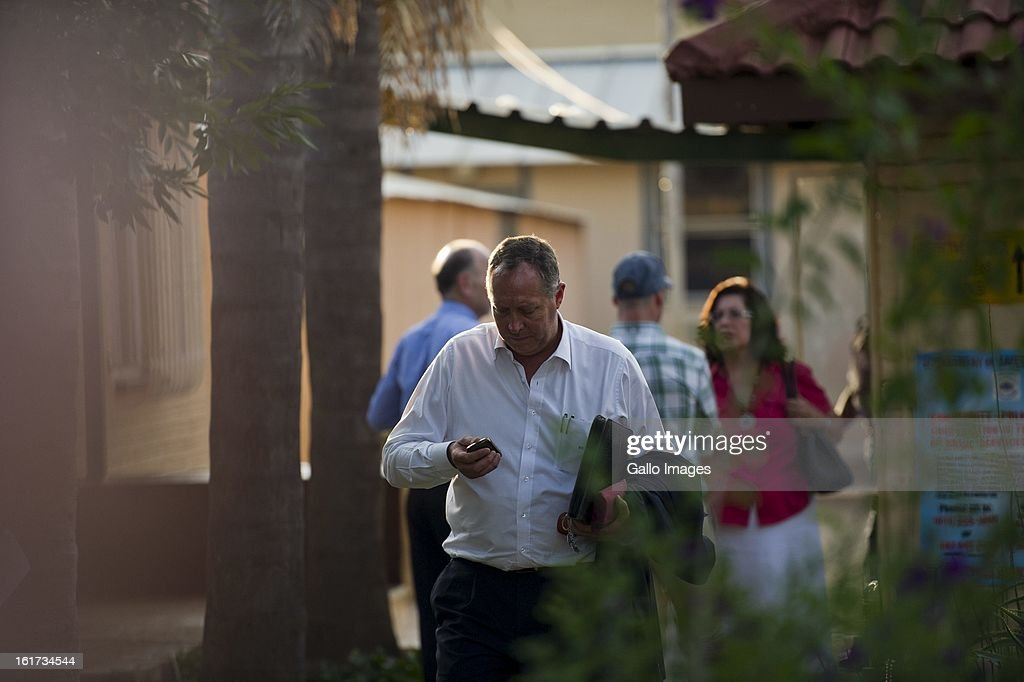 Kenny Oldwage, lawyer to Oscar Pistorius leaves Boschkop Police Station on February 14, 2013 in Pretoria, South Africa. Oscar Pistorius was taken to hospital for a blood test, prior to his appearance at court. He was arrested following a shooting at his residence on the morning of February 14, 2013