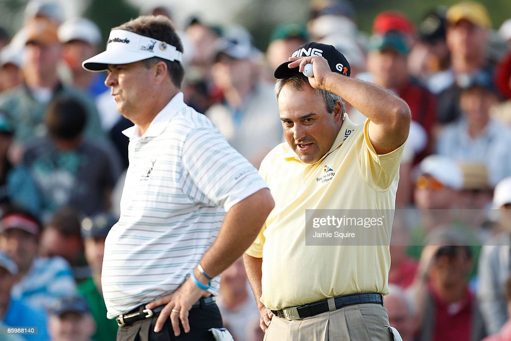 Kenny Perry and Angel Cabrera of Argentina wait on the first sudden death playoff hole during the final round of the 2009 Masters Tournament at Augusta National Golf Club on April 12, 2009 in Augusta, Georgia.