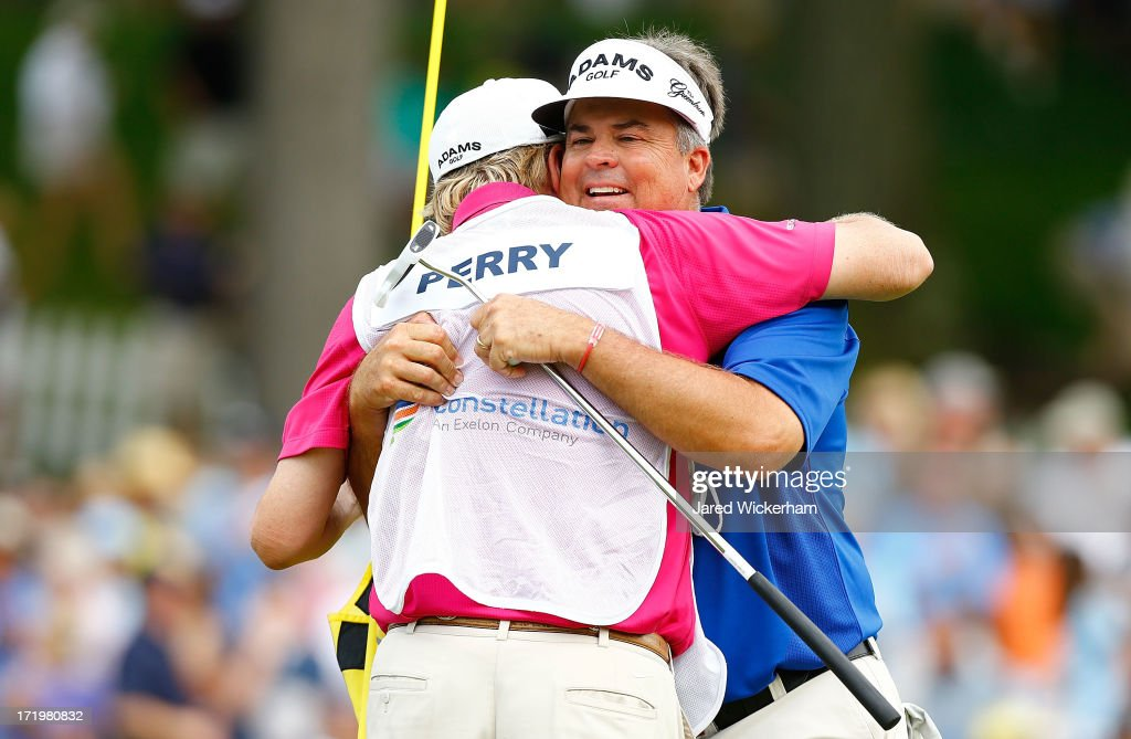 <a gi-track='captionPersonalityLinkClicked' href=/galleries/search?phrase=Kenny+Perry&family=editorial&specificpeople=210558 ng-click='$event.stopPropagation()'>Kenny Perry</a> celebrates with his caddy on the 18th green in the final round after winning the 2013 Constellation Senior Players Championship at Fox Chapel Golf Club on June 30, 2012 in Fox Chapel, Pennsylvania.