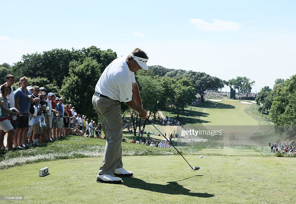 <a gi-track='captionPersonalityLinkClicked' href=/galleries/search?phrase=Kenny+Perry&family=editorial&specificpeople=210558 ng-click='$event.stopPropagation()'>Kenny Perry</a> hits his tee shot on the 15th hole during the final round of the 2013 U.S. Senior Open Championship at Omaha Country Club on July 14, 2013 in Omaha, Nebraska.