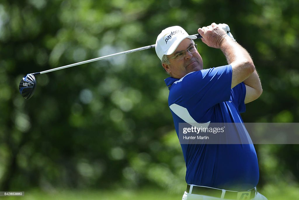<a gi-track='captionPersonalityLinkClicked' href=/galleries/search?phrase=Kenny+Perry&family=editorial&specificpeople=210558 ng-click='$event.stopPropagation()'>Kenny Perry</a> hits his tee shot on the 15th hole during the first round of the Champions Tour American Family Insurance Championship at University Ridge Golf Course on June 24, 2016 in Madison, Wisconsin.
