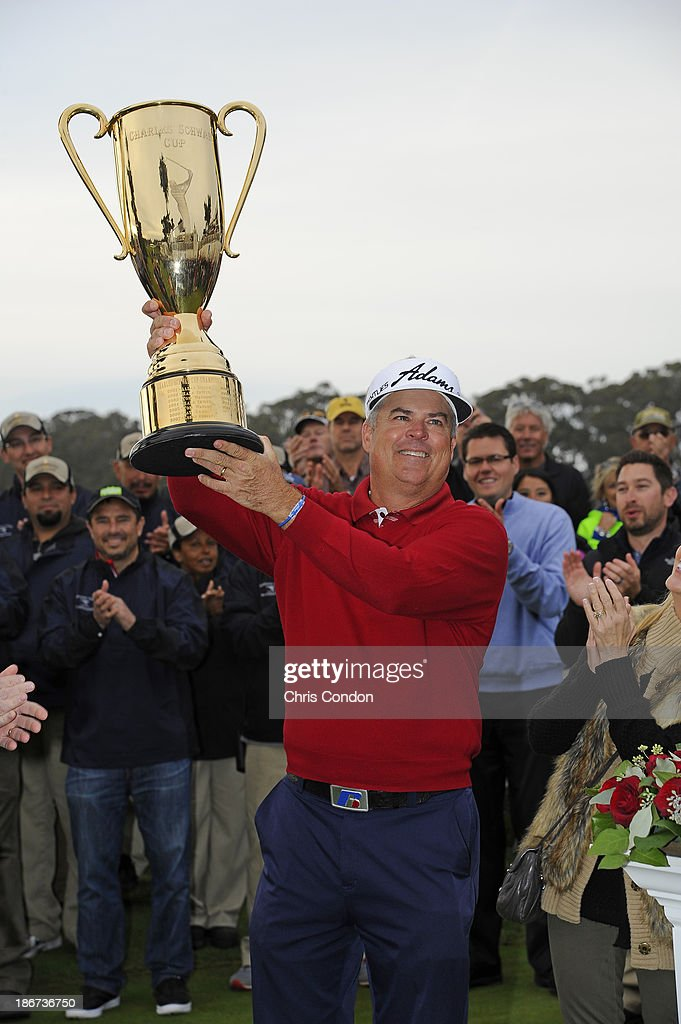 <a gi-track='captionPersonalityLinkClicked' href=/galleries/search?phrase=Kenny+Perry&family=editorial&specificpeople=210558 ng-click='$event.stopPropagation()'>Kenny Perry</a> holds the Charles Schwab Cup after winning the season-long points race during the Charles Schwab Cup Championship at TPC Harding Park on November 3, 2013 in San Francisco, California.