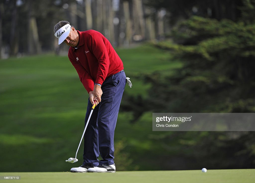 <a gi-track='captionPersonalityLinkClicked' href=/galleries/search?phrase=Kenny+Perry&family=editorial&specificpeople=210558 ng-click='$event.stopPropagation()'>Kenny Perry</a> putts for birdie on the 15th green during the final round of the Charles Schwab Cup Championship at TPC Harding Park on November 3, 2013 in San Francisco, California.