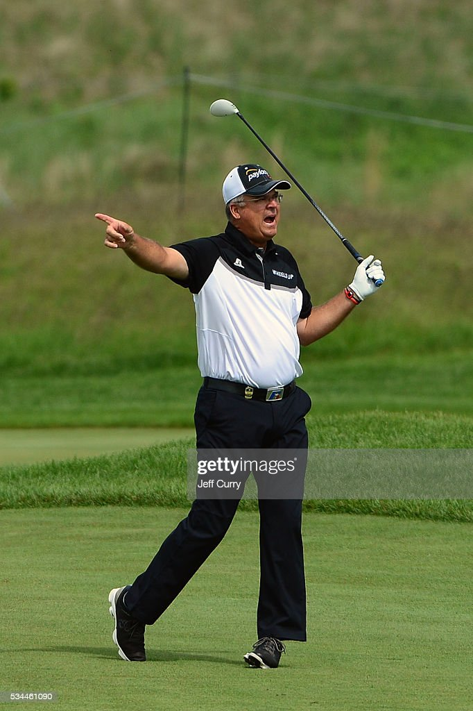 <a gi-track='captionPersonalityLinkClicked' href=/galleries/search?phrase=Kenny+Perry&family=editorial&specificpeople=210558 ng-click='$event.stopPropagation()'>Kenny Perry</a> reacts after slicing a shot on the ninth hole during the first round 2016 Senior PGA Championship presented by KitchenAid at the Golf Club at Harbor Shores on May 26, 2016 in Benton Harbor, Michigan.
