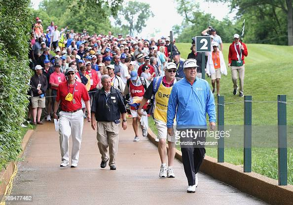 Kenny Perry walks ahead of a group as he crosses the second hole bridge during Round Three of the Senior PGA Championship presented by KitchenAid at...