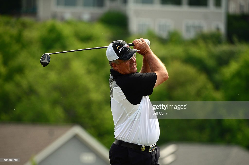 <a gi-track='captionPersonalityLinkClicked' href=/galleries/search?phrase=Kenny+Perry&family=editorial&specificpeople=210558 ng-click='$event.stopPropagation()'>Kenny Perry</a> watches his tee shot on the eighth hole during the first round 2016 Senior PGA Championship presented by KitchenAid at the Golf Club at Harbor Shores on May 26, 2016 in Benton Harbor, Michigan.