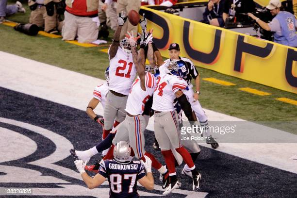 Kenny Phillips of the New York Giants blocks a pass intended for Aaron Hernandez of the New England Patriots by Tom Brady in the end zone in the...
