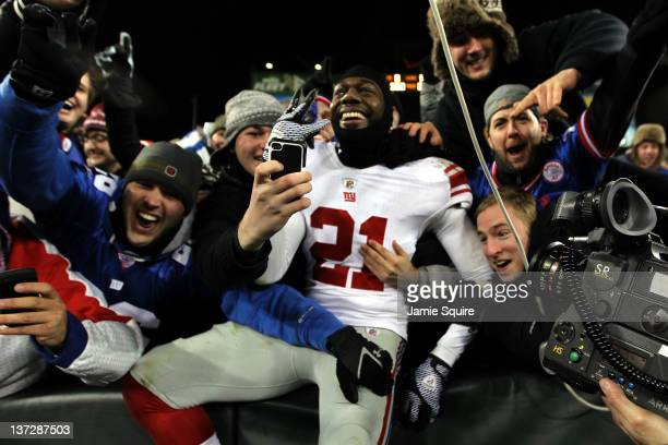 Kenny Phillips of the New York Giants celebrates with fans after a touchdown against the Green Bay Packers during their NFC Divisional playoff game...
