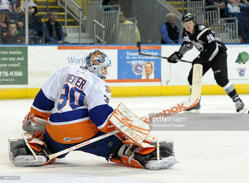 Kenny Reiter #30 of the Bridgeport Sound Tigers makes a save during an American Hockey League game against the Manchester Monarchs on February 23, 2013 at the Webster Bank Arena at Harbor Yard in Bridgeport, Connecticut.