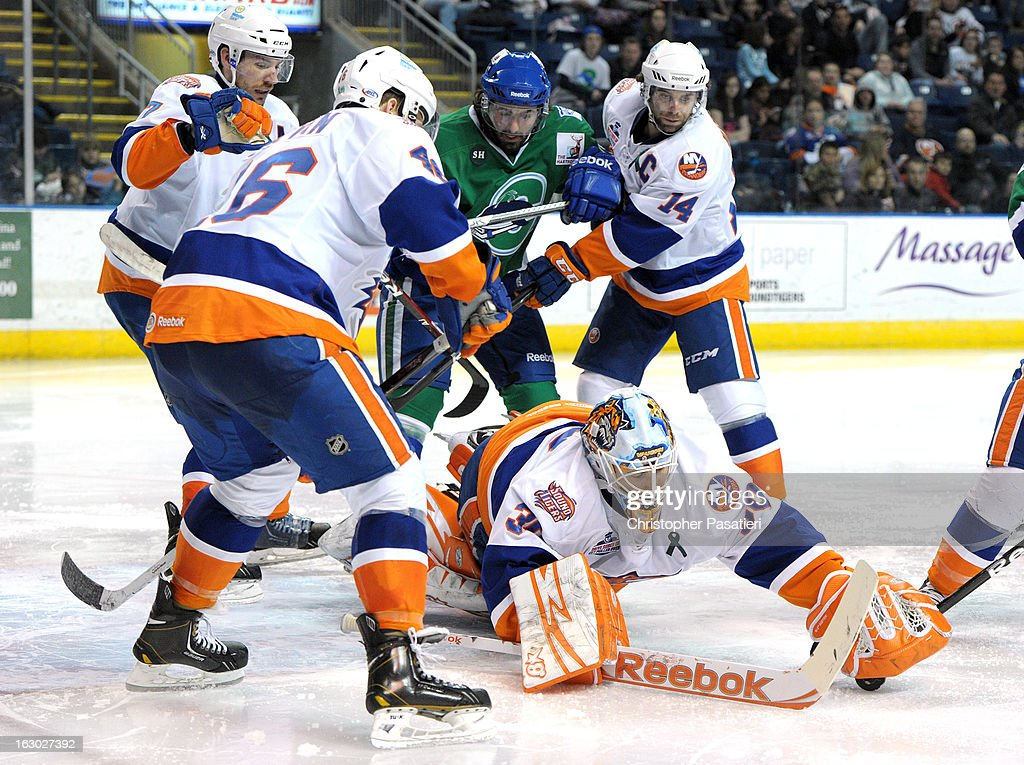 Kenny Reiter #30 of the Bridgeport Sound Tigers makes a save during an American Hockey League game against the Connecticut Whale on March 3, 2013 at the Webster Bank Arena at Harbor Yard in Bridgeport, Connecticut.