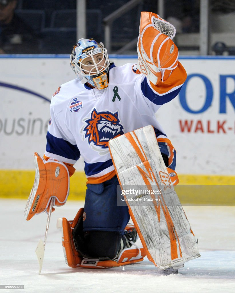 Kenny Reiter of the Bridgeport Sound Tigers makes a save during the warm up prior to an American Hockey League game against the Norfolk Admirals on...