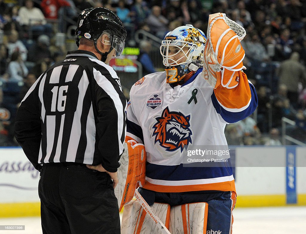 Kenny Reiter #30 of the Bridgeport Sound Tigers talks with the linesman during an American Hockey League game against the Connecticut Whale on March 3, 2013 at the Webster Bank Arena at Harbor Yard in Bridgeport, Connecticut.
