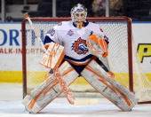 Kenny Reiter of the Bridgeport Sound Tigers tends goal during the warm up prior to an American Hockey League game against the Norfolk Admirals on...