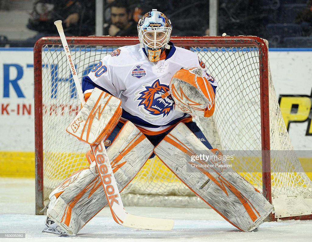 Kenny Reiter #30 of the Bridgeport Sound Tigers tends goal prior to an American Hockey League game against the Connecticut Whale Tigers on March 3, 2013 at the Webster Bank Arena at Harbor Yard in Bridgeport, Connecticut.