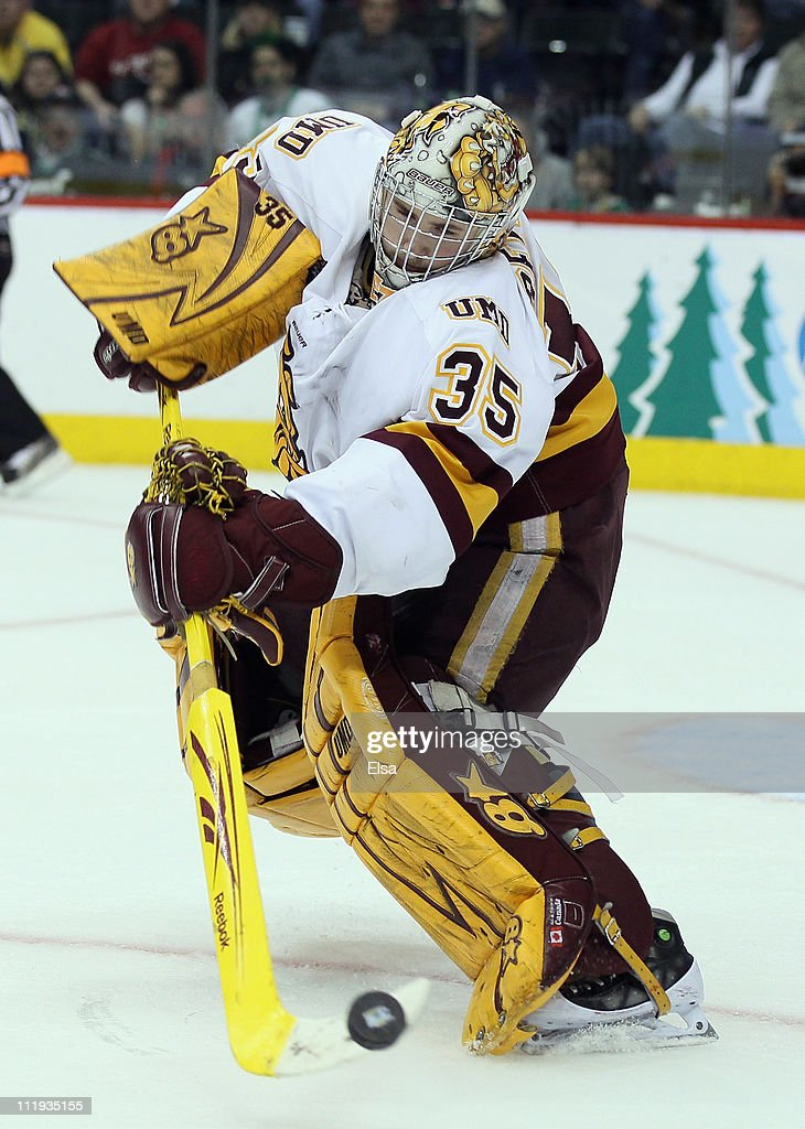 Kenny Reiter #35 of the Minnesota Duluth Bulldogs clears the puck during semifinals of the 2011 NCAA Men's Frozen Four on April 7, 2011 at the Xcel Energy Center in St. Paul, Minnesota. The Minnesota Duluth Bulldogs defeated the Notre Dame Fighting Irish 4-3.