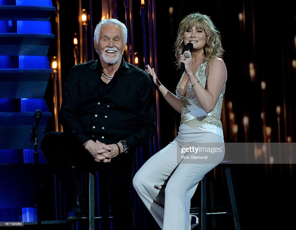 Kenny Rogers (L) and Jennifer Nettles perform onstage during the 47th annual CMA Awards at the Bridgestone Arena on November 6, 2013 in Nashville, Tennessee.