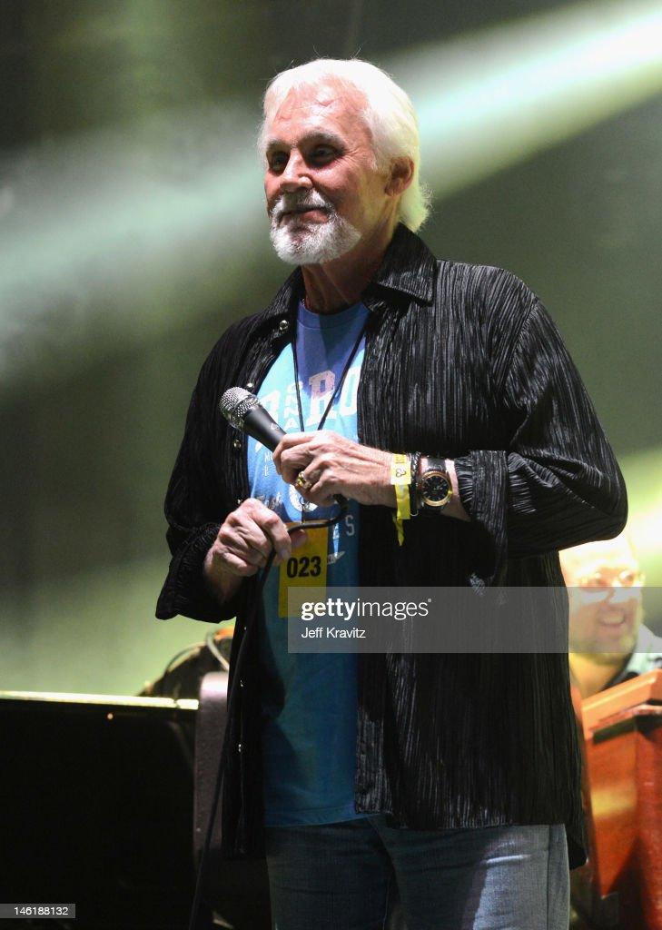 Kenny Rogers performs with Phish onstage during Day 4 of Bonnaroo 2012 on June 10, 2012 in Manchester, Tennessee.