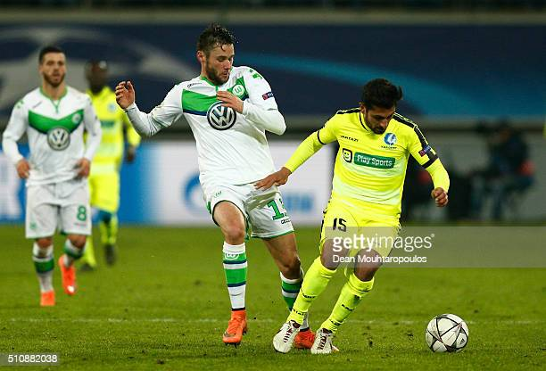 Kenny Saief of KAA Gent is challenged by Christian Traesch of Wolfsburg during the UEFA Champions League round of 16 first leg match between KAA Gent...