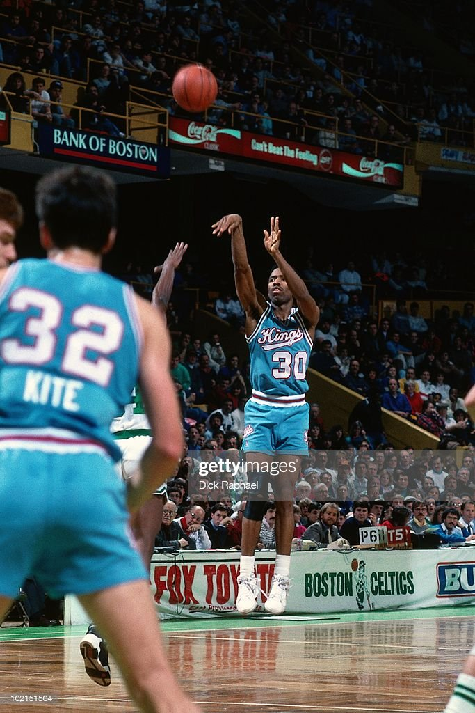 Kenny Smith #30 of the Sacramento Kings shoots a jump shot against the Boston Celtics during a game played in 1990 at the Boston Garden in Boston, Massachusetts.