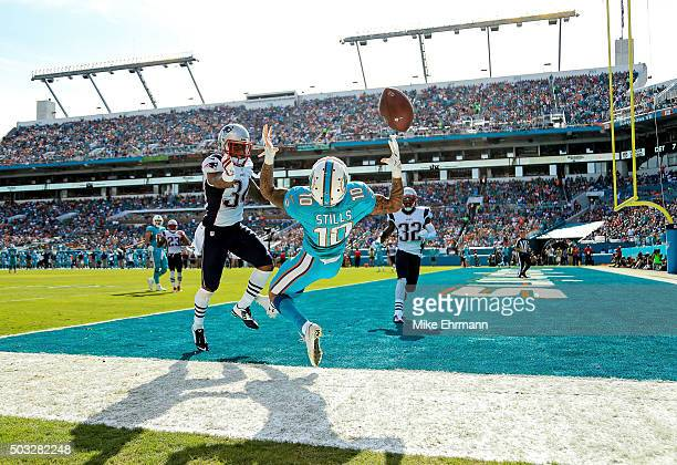 Kenny Stills of the Miami Dolphins attempts to catch a pass while Leonard Johnson of the New England Patriots defends during the first half of the...