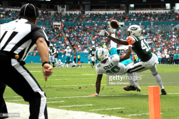 Kenny Stills of the Miami Dolphins attempts to make the catch over Buster Skrine of the New York Jets during a game at Hard Rock Stadium on October...