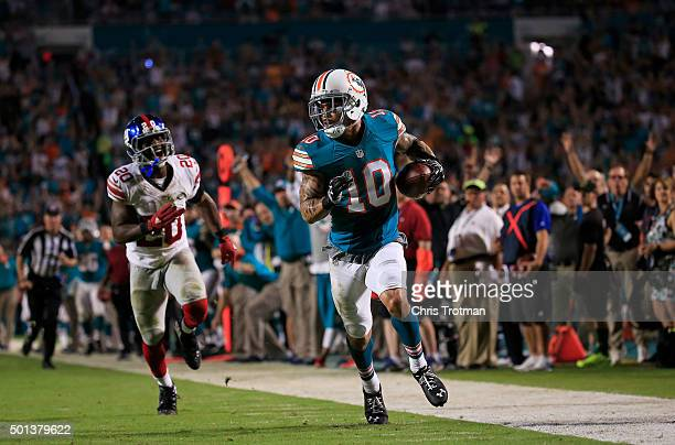 Kenny Stills of the Miami Dolphins catches a pass past Prince Amukamara of the New York Giants for a touchdown during the second half of the game at...