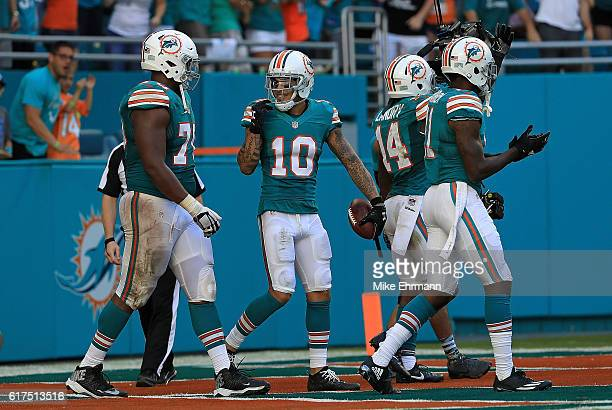 Kenny Stills of the Miami Dolphins celebrates a touchdown during a game against the Buffalo Bills at Hard Rock Stadium on October 23 2016 in Miami...