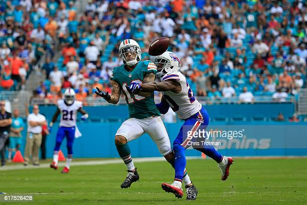 Kenny Stills of the Miami Dolphins goes up for a ball and is defended by Corey Graham of the Buffalo Bills at the Hard Rock Stadium on October 23...