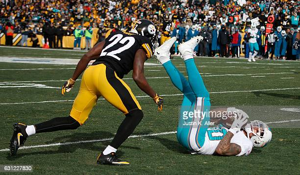 Kenny Stills of the Miami Dolphins holds onto the ball after a catch in front of William Gay of the Pittsburgh Steelers in the first half during the...