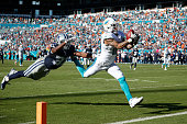 Kenny Stills of the Miami Dolphins makes a 29yard touchdown reception against Byron Jones of the Dallas Cowboys in the third quarter of the game at...