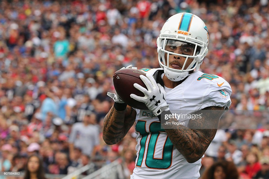 Kenny Stills #10 of the Miami Dolphins makes a touchdown reception during the third quarter against the New England Patriots at Gillette Stadium on September 18, 2016 in Foxboro, Massachusetts.