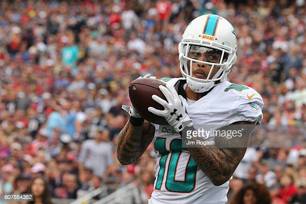 Kenny Stills of the Miami Dolphins makes a touchdown reception during the third quarter against the New England Patriots at Gillette Stadium on...