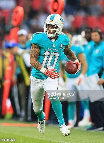 Kenny Stills of the Miami Dolphins runs with the ball during the game against New York Jets at Wembley Stadium on October 4 2015 in London England