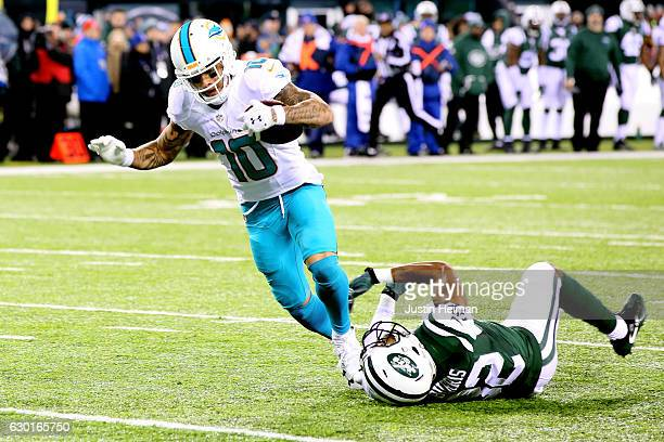 Kenny Stills of the Miami Dolphins scores a 52 yard touchdown against Juston Burris of the New York Jets during the second quarter of the game at...