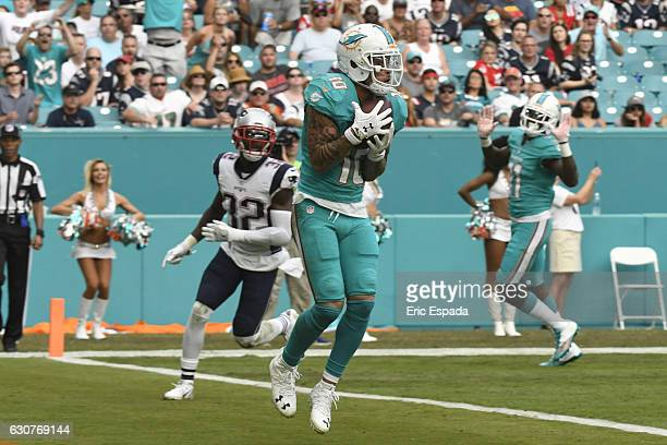 Kenny Stills of the Miami Dolphins scores a touchdown during the 3rd quarter against the New England Patriots at Hard Rock Stadium on January 1 2017...