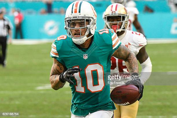 Kenny Stills of the Miami Dolphins scores a touchdown in the 3rd quarter against the San Francisco 49ers at Hard Rock Stadium on November 27 2016 in...