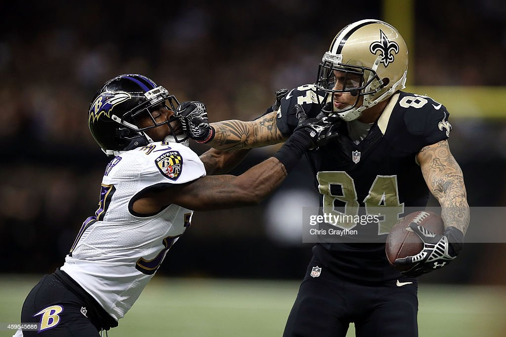 Kenny Stills #84 of the New Orleans Saints is pursued by Danny Gorrer #37 of the Baltimore Ravens during the fourth quarter of a game at the Mercedes-Benz Superdome on November 24, 2014 in New Orleans, Louisiana.