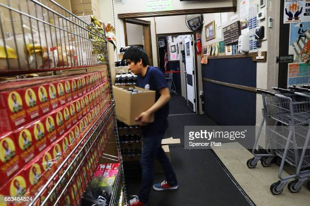 Kenny Tapia works at the Reaching Out Community Services food pantry in Brooklyn on May 15 2017 in New York City The popular Brooklyn food pantry...