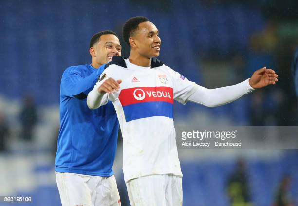 Kenny Tete and Memphis Depay of Olympique Lyon celebrate after the UEFA Europa League group E match between Everton FC and Olympique Lyon at Goodison...
