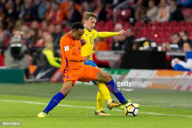 Kenny Tete of Netherlands and Emil Forsberg of Sweden battle for the ball during the FIFA 2018 World Cup Qualifier between Netherlands and Sweden at...