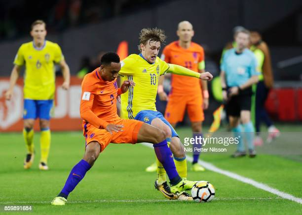 Kenny Tete of Netherlands and Emil Forsberg of Sweden competes for the ball during the FIFA 2018 World Cup Qualifier between Netherlands and Sweden...