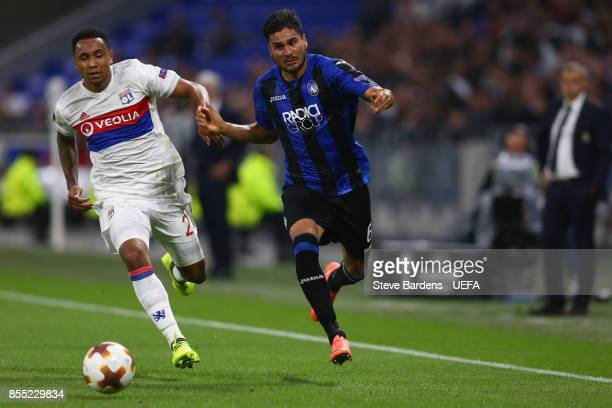 Kenny Tete of Olympique Lyonnais Lyon challenges for the ball with José Luis Palomino of Atalanta during the UEFA Europa League group E match between...