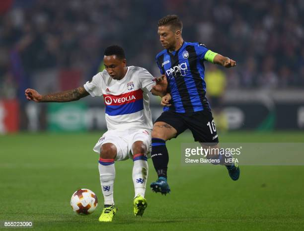 Kenny Tete of Olympique Lyonnais Lyon is tackled by Alejandro Gómez of Atalanta during the UEFA Europa League group E match between Olympique...
