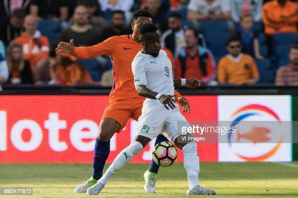 Kenny Tete of The Netherlands Maxwell Cornet of Ivory Coastduring the friendly match between The Netherlands and Ivory Coast at the Kuip on June 4...