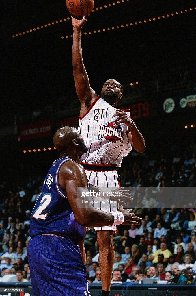 Kenny Thomas #21 of the Houston Rockets goes up for a shot over Karl Malone #32 of the Utah Jazz during the game on March 27, 2001 at the Compaq Center in Houston, Texas. The Rockets won 109-86.