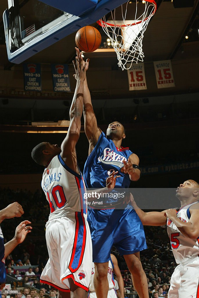 Kenny Thomas #9 of the Philadelphia 76ers goes up for the layup against Kurt Thomas #40 of the New York Knicks at Madison Square Garden on April 11, 2003 in New York, New York.