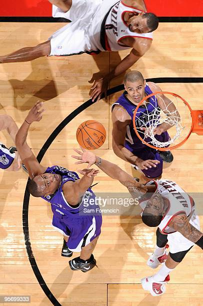 Kenny Thomas of the Sacramento Kings and LaMarcus Aldridge of the Portland Trail Blazers go after a rebound during the game on December 15 2009 at...
