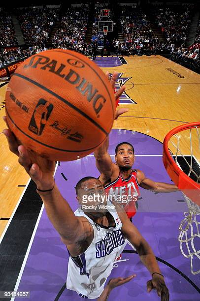 Kenny Thomas of the Sacramento Kings gets to the basket around Sean Williams of the New Jersey Nets on November 27 2009 at ARCO Arena in Sacramento...